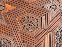 Wood work. Detail of a wood door of a muslim mosque in Marrakech, Morroco Royalty Free Stock Photo