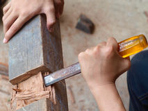 Wood work with Chisel. Working with chisel to remove a part of wood royalty free stock images