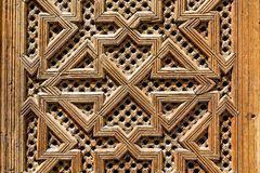 Wood work in a square pattern on the doors of a madarsa  in Fes, Morocco. Stock Photos