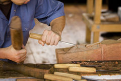Wood Worker. Artisan working with mallet and chisel Stock Images