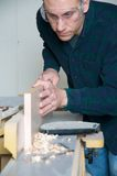 A wood worker. Using power tools in a work shop Royalty Free Stock Photos