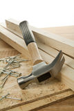 Wood working. Wooden planks, hammer and nails Royalty Free Stock Images