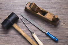 Wood working. Image shows different carpenter tools on wooden table stock photography