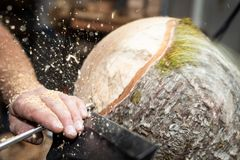 Wood working man cuts rotating piecee of timber royalty free stock images
