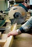 Wood workshop. – cutting timber with circular saw Stock Photo