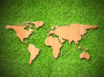 Wood World map on green grass Royalty Free Stock Photos