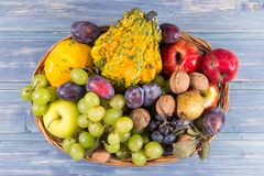 Wood woven basket full of autumn fruits Stock Photography