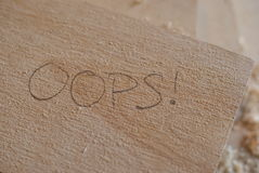 Wood writing Oops! Stock Photos