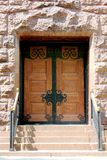 Wood and Wrought Iron Double Doors Stock Image