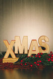 Wood Xmas Letters Background and Holly Branch and Berries Royalty Free Stock Photography
