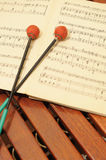 Wood xylophone with notes and mallets. A photo close up. Original color Royalty Free Stock Photo