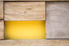 Wood and yellow concrete wall texture Stock Photography