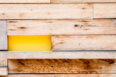 Wood and yellow concrete wall texture Royalty Free Stock Image