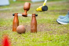 Woodball player on field with woodball gate and stick on competi