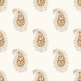 Seamless paisley blockprint pattern. Woodblock printed seamless paisley pattern. Traditional Indian oriental ethnic ornament, brown and golden hues on ecru Royalty Free Stock Image