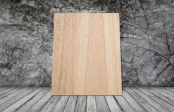 Woodboard on grunge wallpaper Stock Photo