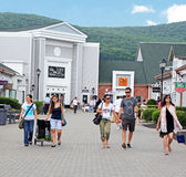 Woodbury Commons Outlets. Shoppers at Woodbury commons premium outlets,a famous NY outlet shopping village located at central valley,upstate NY royalty free stock image