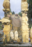 A woodcarver displaying his bear totem Stock Image