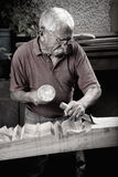 Woodcarver working with mallet and chiesel Stock Photos