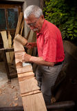 Woodcarver working with mallet and chisel 4 Royalty Free Stock Images