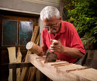 Woodcarver working with mallet and chisel 5 Royalty Free Stock Image