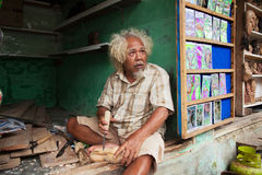 Woodcarver working in the village Royalty Free Stock Images