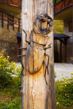 Woodcarving bug on wood background, beetle Lucanus Cervus, Stag beetle. Royalty Free Stock Photo