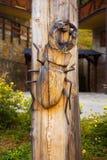 Woodcarving bug on wood background, beetle Lucanus Cervus, Stag beetle. Royalty Free Stock Photo