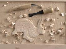 Woodcarving dans l'allégement Photographie stock