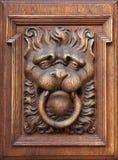 Woodcarving eines lionshead Stockbilder