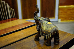 Woodcarving elephant on table Stock Photography