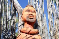 Woodcarving facial expressions, Namibia Stock Photo