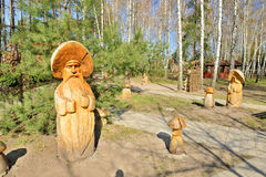 Woodcarving. Figures fungi. Stock Photos
