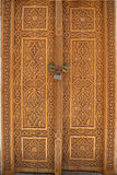 Woodcarving. National Samarkand patterns. Woodcarving. The old door is locked. National Samarkand patterns Stock Images