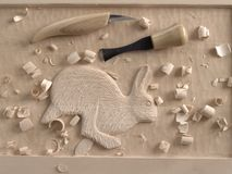 Woodcarving in relief Stock Photography