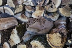 Woodcarving shoes over wood Stock Photo