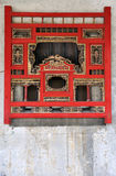 Woodcarving window in Chinese traditional style. Wooden window in Chinese traditional style with exquisite woodcarving in red and golden color, shown as Stock Photo