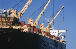 Woodchip being loaded on to bulk carrier ship for export Royalty Free Stock Images