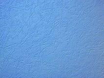 Woodchip wallpaper as background. Light blue woodchip wallpaper as background Royalty Free Stock Photo