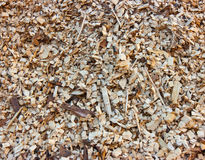Woodchips. Detail of a woodchips pile in a biomass power plant stock photos
