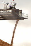 Woodchips. A conveyor belt fed gantry spraying woodchips onto a pile Royalty Free Stock Photo