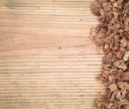 Woodchips on fir board Royalty Free Stock Images