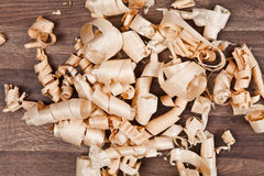 Woodchips (shavings) on wooden surface Stock Photography