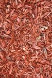 Woodchips vermelhos como o fundo. imagem de stock