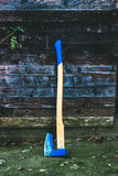 Woodchopping Axe. Blue woodchopping axe lean on wooden wall Stock Image