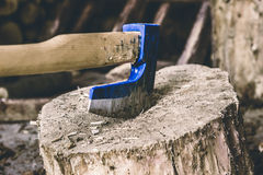 Woodchopping axe. Blue woodchopping axe. Selective focus Royalty Free Stock Photo