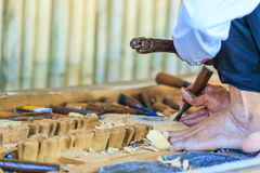 Woodcraftsman is carving wood Royalty Free Stock Images