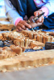 Woodcraftsman is carving wood Stock Photos