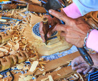 Woodcraftsman is carving wood Royalty Free Stock Photography