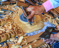 Woodcraftsman is carving wood Stock Photography